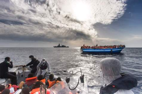 """June 7, 2014 - Mediterranean Sea / Italy: Refugees rescued off a boat and carried onto an Italian navy ship on a mission to seek asylum seekers fleeing Africa and the Middle east through Libya. More than 2,000 migrants jammed in 25 boats arrived in Italy June 12, ending an international operation to rescue asylum seekers traveling from Libya. They were taken to three Italian ports and likely to be transferred to refugee centers inland. Hundreds of women and dozens of babies, were rescued by the frigate FREMM Bergamini as part of the Italian navy's """"Mare Nostrum"""" operation, launched last year after two boats sank and more than 400 drowned. Favorable weather is encouraging thousands of migrants from Syria, Eritrea and other sub-Saharan countries to arrive on the Italian coast in the coming days. Cost of passage is in the 2,500 Euros range for Africans and 3,500 for Middle Easterners, per person. Over 50,000 migrants have landed Italy in 2014. Many thousands are in Libya waiting to make the crossing. (Massimo Sestini/Polaris)"""